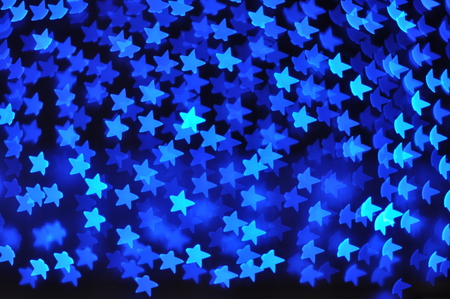 stelle blu: Beautiful holiday background with blue stars defocused lights