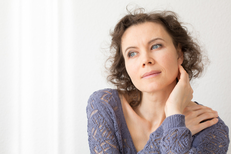 femme romantique: Romantic woman thinking about something