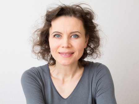 Happy woman with attractive smile looking into