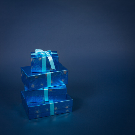 blue gift box: Four gift boxes wth ribbon bow in vertical composition Stock Photo