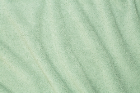 Terry bath towel waves background in green color