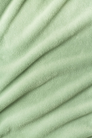 terry: Terry bath towel waves background in green color
