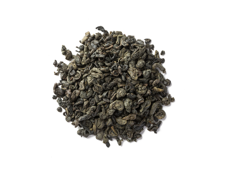 Green tea dried leaves placed in round form of circle, top view