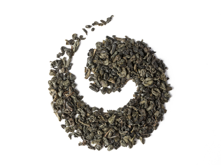 Green tea dried leaves placed in a form of whirl