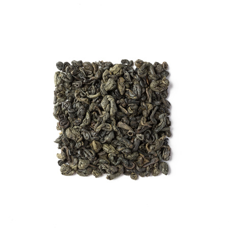 Green tea dried leaves placed in a form of square