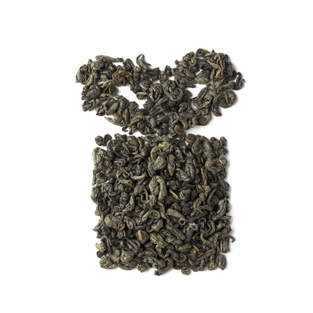 Green tea dried leaves placed in a form of gift box Фото со стока