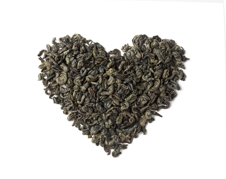 Green tea dried leaves placed in a form of heart