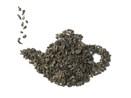 Green tea dried leaves placed in a form of teapot