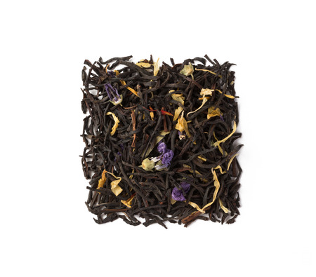 Black herbal flower tea dry leaves placed in a form of square isolated on white
