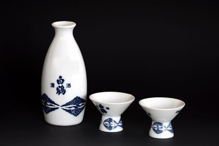 Sake set for two people on thunder grey gradient background. Stock Photo