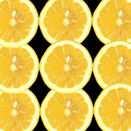 nines: Nine slices of lemon on a black background
