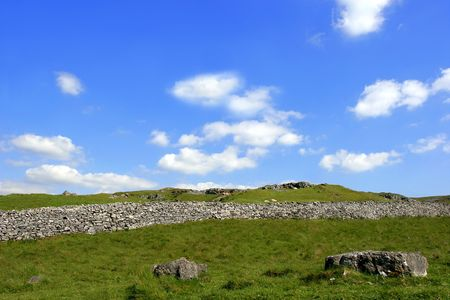 Old stone wall, set in countryside on a blue sky day in the Brecon Beacons National Park, Wales, UK. photo