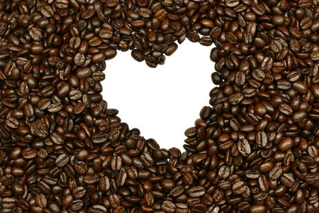 Fresh coffee beans with a white heart at the center. photo