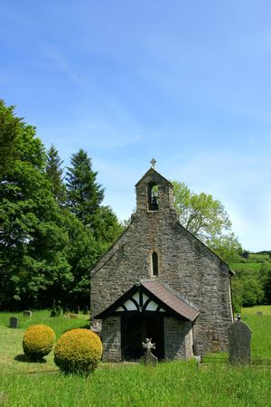 quietness: Ancient church and graveyard on a blue sky day, at Ffarmers, Carmarthenshire, Wales, United Kingdom.