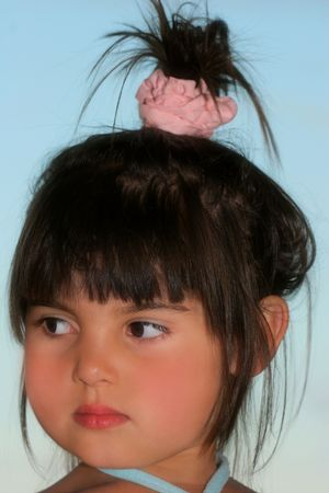 kiddies: Face of a little girl with a top knot hair style. Stock Photo