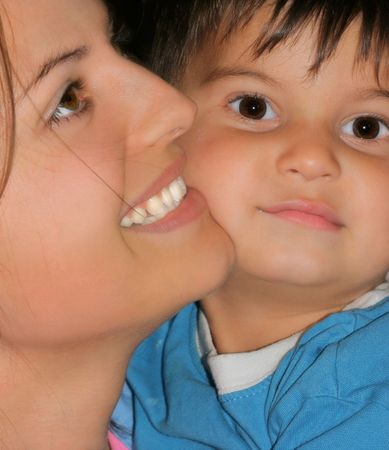 gentleness: Profile of a woman and the face of her little boy.