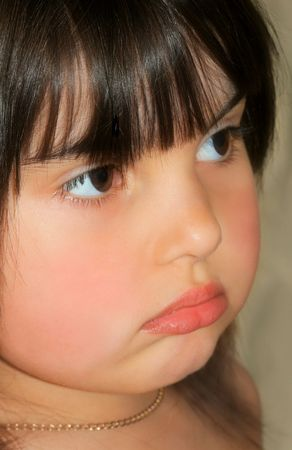 Profile of a little girl pouting. photo
