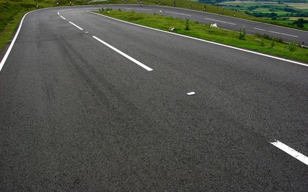 A severe bend with skid marks on a mountain road in the Brecon Beacons National Park, Wales, UK. Stock Photo - 330989