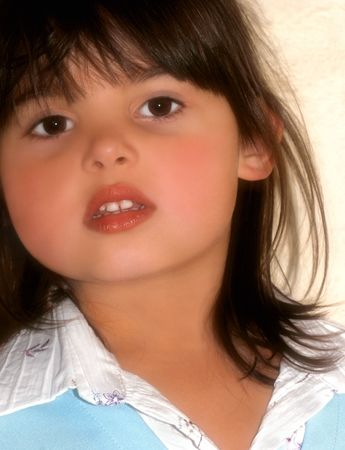 kiddies: Face of a little girl with rosebud shaped lips, brown hair and brown eyes.