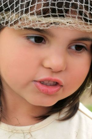 Face of a little girl with rosebud lips.