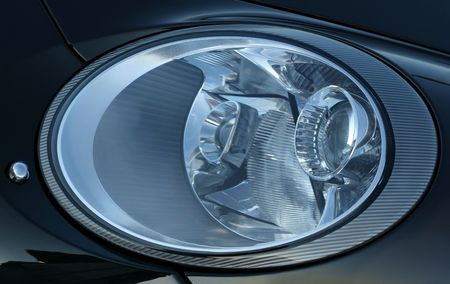 computerised: Headlights on a sports car. Stock Photo