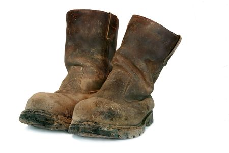 capped: Pair of brown leather well worn steel toe capped builders boots, covered in mud and paint splatters.