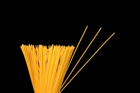 Spaghetti against a black background. Stock Photo - 347438