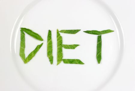 meagre: The word diet spelt out in lettuce on a white china plate.