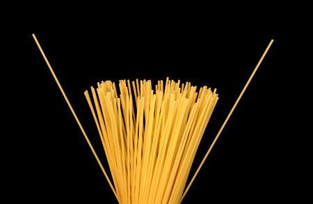 Spaghetti against a black background. Stock Photo - 347400
