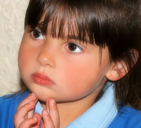 Face of a little girl deep in thought. photo