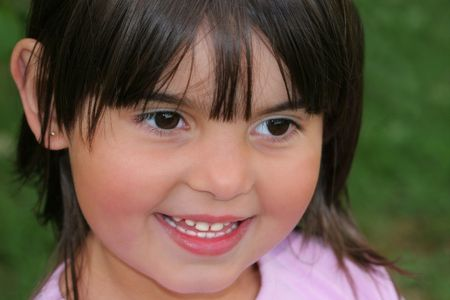 kiddies: Face of a little girl smiling.