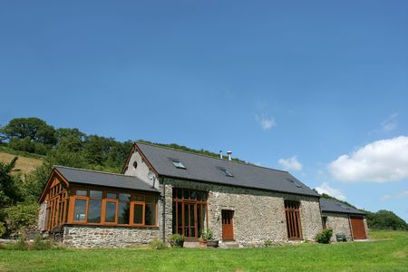 restored: Newly restored stone barn with slate roof in rural countryside. Stock Photo