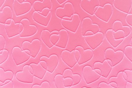 embossed: Pastel pink linked hearts embossed on paper.