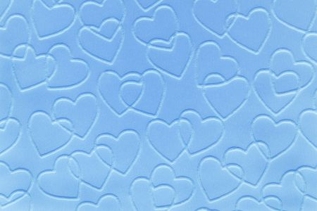 embossed paper: Pastel blue double linked hearts embossed on paper.