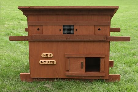 on the skids: Wooden chicken house standing on the grass.