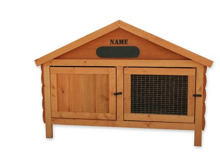 hutch: Wooden tongue and groove rabbit hutch, over white.