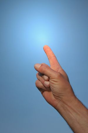 Hand of a man pointing his forefinger to towards a blue sky with a light glow coming from his forefinger. Focus on the forefinger. Stock Photo - 760629
