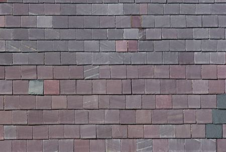 walling: Wall of grey and smoky purple welsh slates. Slates are often used in the building industry to cover the sides of buildings to protect them from driving rain.