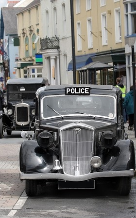collectable: Vintage black and chrome british police car standing idle in a street. Stock Photo