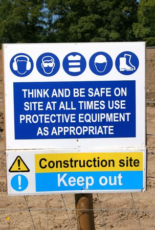 Construction site safety regulation sign with symbols and warnings.