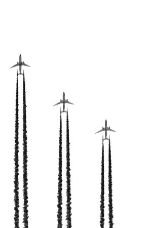 unsustainable: Absract of three jet aircraft flying in a vertical parallel formation with dark smoke trails, set against a white background. Stock Photo