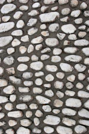cobble: Cobble pietre fissato in cemento su un vecchio percorso.  Archivio Fotografico