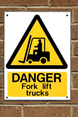 Fork lift truck operating warning sign fixed to a brick wall. photo