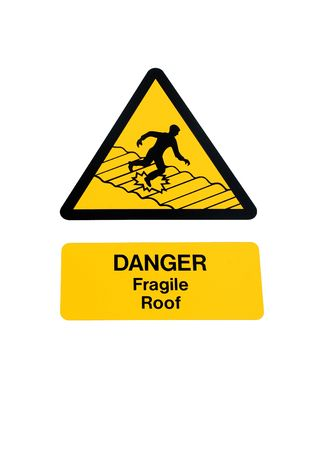 Fragile roof warning sign in yellow and black, isolated over white. photo