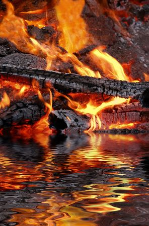embers: Abstract of wood fire with reflection over water. Stock Photo
