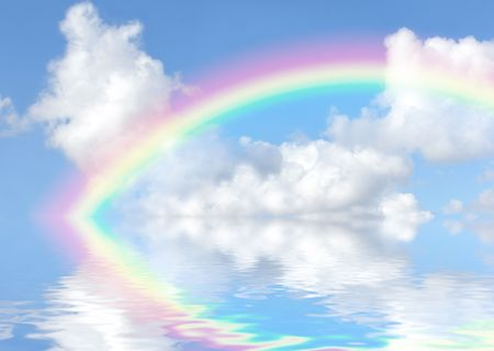 dreamland: Fantasy abstract of a blue sky, rainbow, and cumulus clouds with reflection over rippled water. Stock Photo