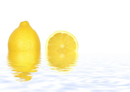 Abstract of a lemon and lemon slice both partially submerged in gently rippled blue water with reflection and set against a white background. photo