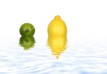Abstract of a lemon and lime partially submerged in gently rippled blue water with reflection and set against a white background. photo