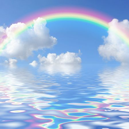 Abstract of a blue sky with a rainbow and cumulus clouds, reflected over water.