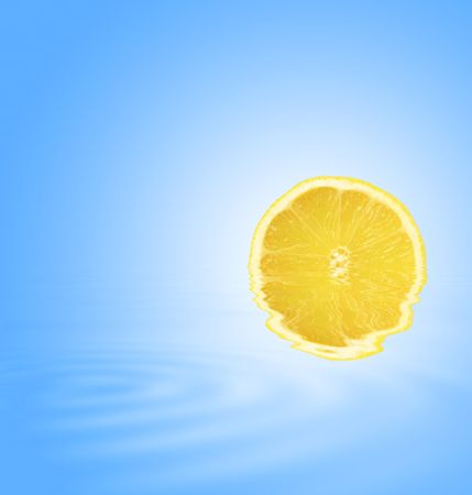 bue: Abstract of a lemon slice partially submerged in gently rippled blue water with reflection. Set against a sky bue background with white central glow.